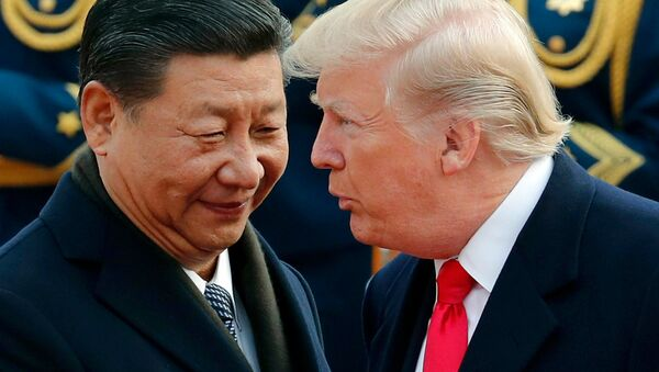 In this Nov. 9, 2017, file photo, U.S. President Donald Trump, right, chats with Chinese President Xi Jinping during a welcome ceremony at the Great Hall of the People in Beijing - Sputnik International