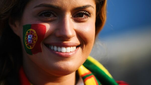 A fan of the Portugal national team before the start of a group stage match between Portugal and Spain. - Sputnik International