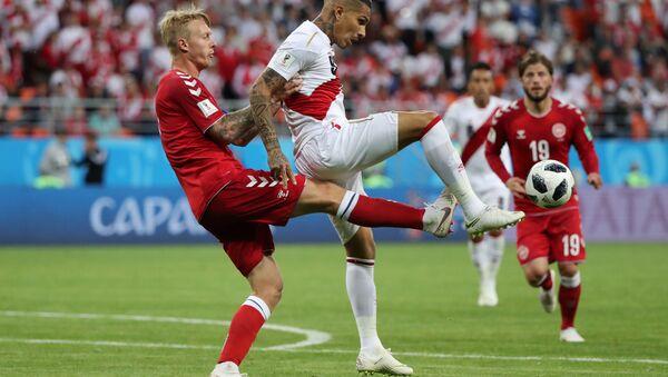 Denmark's Simon Kjaer in action with Peru's Paolo Guerrero, Peru vs Denmark - Mordovia Arena, Saransk, Russia - June 16, 2018 - Sputnik International