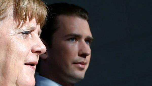 German Chancellor Angela Merkel and Austrian Chancellor Sebastian Kurz arrive at a news conference in the chancellery in Berlin - Sputnik International