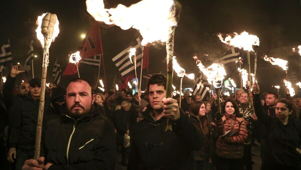 Supporters of Greece's extreme right Golden Dawn party raise torches during a rally commemorating a 1996 military incident which cost the lives of three Greek navy officers and brought Greece and Turkey to the brink of war, in Athens, on Saturday, Feb. 3, 2018 - Sputnik International