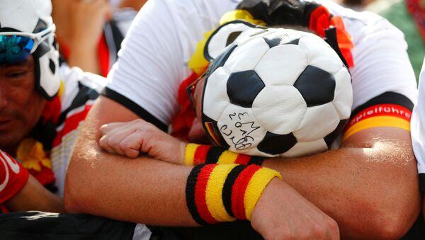 Soccer Football - World Cup - Group F - Germany vs Mexico - Berlin - Germany - June 17, 2018 - Germany fans during the match at Brandenburg Gate - Sputnik International