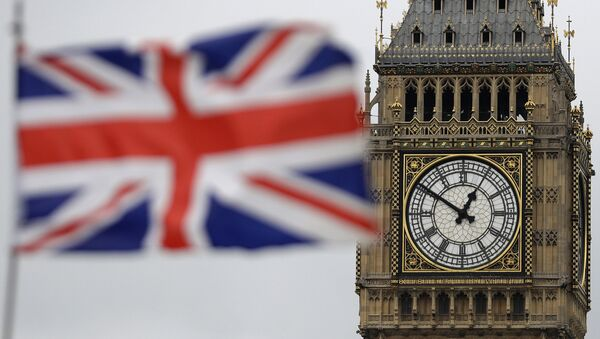a British flag is blown by the wind near Big Ben's clock tower in front of the UK Houses of Parliament in central London - Sputnik International
