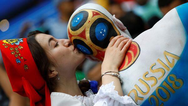 Soccer Football - World Cup - Group A - Russia vs Saudi Arabia - Luzhniki Stadium, Moscow, Russia - June 14, 2018 Russia fan with body paint before the match - Sputnik International