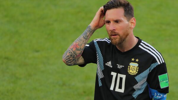 Dejected Argentina's Lionel Messi reacts leaving a pitch after the 1-1 draw at World Cup Group D soccer match between Argentina and Iceland at the Spartak stadium in Moscow, Russia, June 16, 2018 - Sputnik International