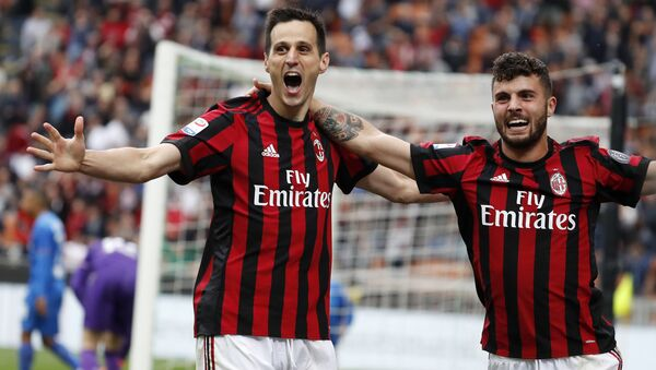 AC Milan's Nikola Kalinic, left, celebrates with his teammate Patrick Cutrone after scoring his side's third goal during the Serie A soccer match between AC Milan and Fiorentina at the San Siro stadium in Milan, Italy, Sunday, May 20, 2018 - Sputnik International