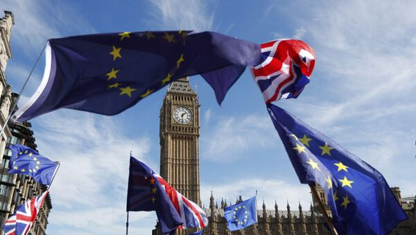 EU and Union flags fly above Parliament Square during a Unite for Europe march, in central London, Britain - Sputnik International