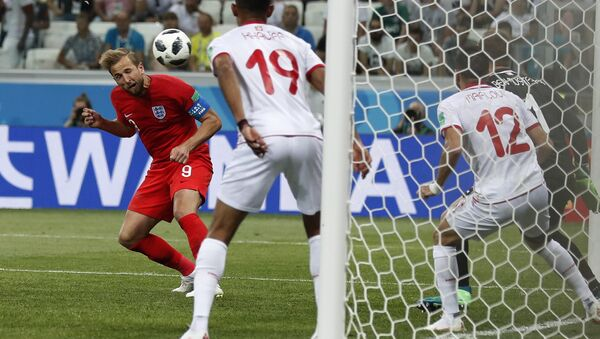 England's Harry Kane scores his side's 2nd goal against Tunisia during a group G match at the 2018 soccer World Cup in the Volgograd Arena in Volgograd, Russia, Monday, June 18, 2018. - Sputnik International