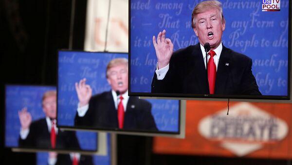 Donald Trump is shown on TV monitors in the media filing room on the campus of University of Nevada, Las Vegas, during the last 2016 U.S. presidential debate in Las Vegas, US, October 19, 2016. - Sputnik International