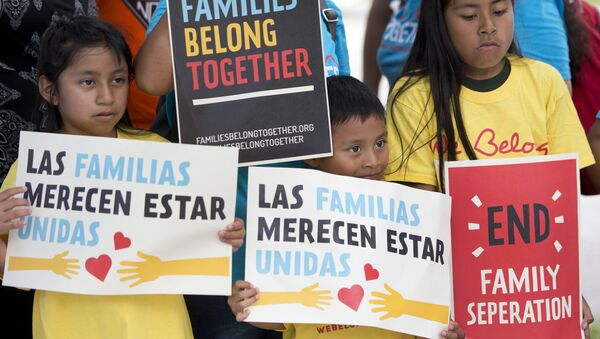 In this June 1, 2018, file photo, children hold signs during a demonstration in front of the Immigration and Customs Enforcement offices in Miramar, Fla. The Trump administration's move to separate immigrant parents from their children on the U.S.-Mexico border has turned into a full-blown crisis in recent weeks - Sputnik International