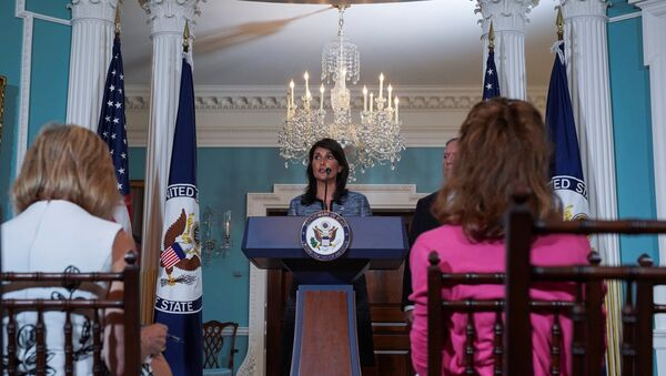 U.S. Ambassador to the United Nations Nikki Haley delivers remarks to the press together with U.S. Secretary of State Mike Pompeo, announcing the U.S.'s withdrawal from the U.N's Human Rights Council at the Department of State in Washington, U.S., June 19, 2018 - Sputnik International