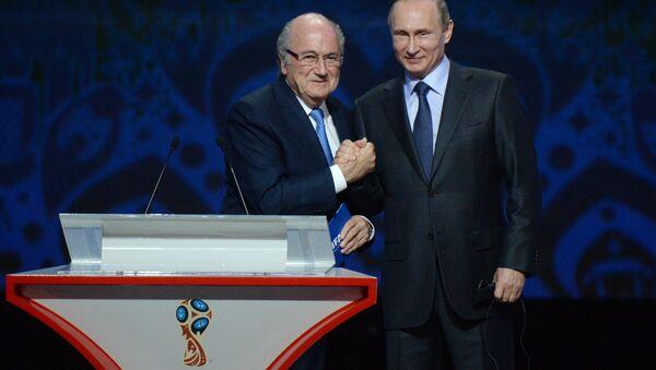 July 25, 2015. Russian President Vladimir Putin (right) and FIFA President Sepp Blatter during the FIFA 2018 World Cup Preliminary Draw (File) - Sputnik International