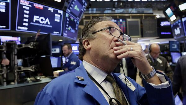 Trader Steven Kaplan works on the floor of the New York Stock Exchange, Tuesday, June 19, 2018. U.S. stock markets are opening sharply lower Tuesday as tensions over trade between the U.S. and China seem closer to a boil - Sputnik International