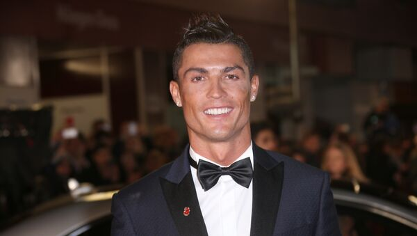 Cristiano Ronaldo poses for photographers upon arrival at the world premiere of the film 'Ronaldo' in London on 9 November 2015 - Sputnik International