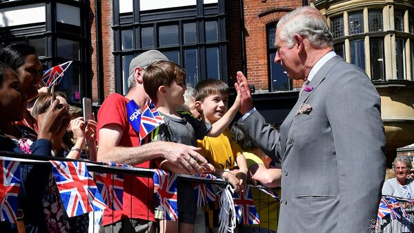 Britain's Prince Charles 'high-fives' a well-wisher during visit to Salisbury in southwest Britain, June 22, 2018 - Sputnik International