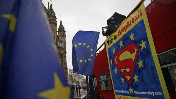 (File) Anti-Brexit demonstrators wave European Union flags from the top deck of a bus parked outside the Houses of Parliament in London on March 29, 2018 - Sputnik International