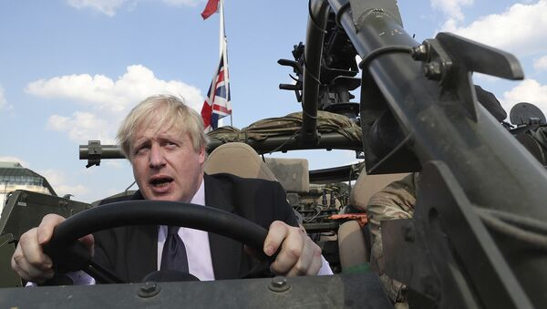 Britain's Foreign Secretary Boris Johnson talks to a British armed forces serviceman based in Orzysz, in northeastern Poland, during a ceremony at the Tomb of the Unknown Soldier and following talks on security with his Polish counterpart Jacek Czaputowicz in Warsaw, Poland, Thursday, June 21, 2018 - Sputnik International