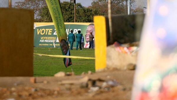 Police officers are seen at the White City Stadium, where Zimbabwe President Emmerson Mnangagwa escaped unhurt after an explosion rocked the stadium, in Bulawayo, Zimbabwe, June 23,2018 - Sputnik International