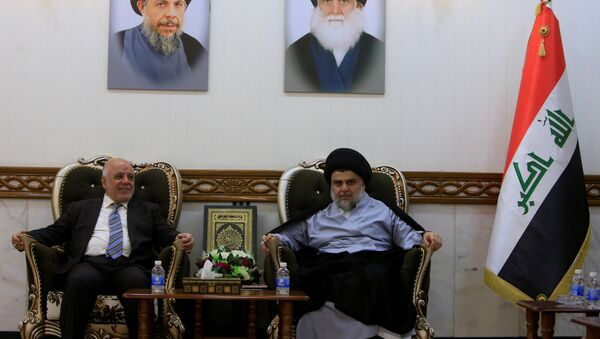 Iraqi Prime Minister Haider al-Abadi, who's political bloc came third in a May parliamentary election, meets with cleric Moqtada al-Sadr, who's bloc came first, in Najaf - Sputnik International