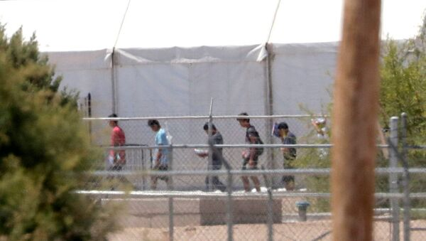 Detainees are seen outside tent shelters used to hold separated family members, Friday, June 22, in Fabens, Texas. The U.N human rights office says President Donald Trump's decision to stop the U.S. policy separating migrant parents from their children doesn't go far enough - Sputnik International