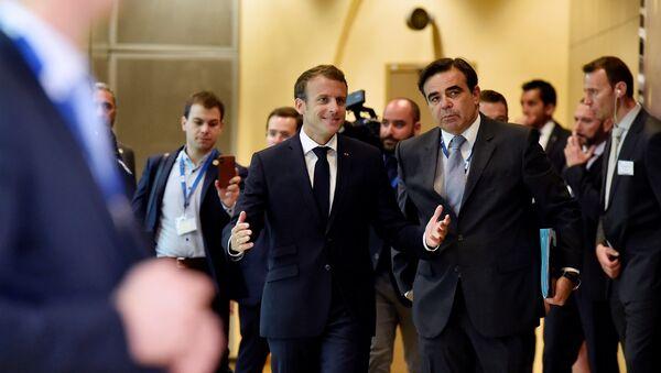 French President Emmanuel Macron arrives to take part in an emergency European Union leaders summit on immigration, in Brussels, Belgium June 24, 2018 - Sputnik International