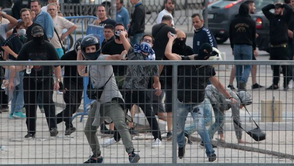 Protesters throw stones during clashes with riot police in a protest against the agreement reached by Greece and Macedonia to resolve a dispute over the former Yugoslav republic's name, in Thessaloniki, Greece, June 25, 2018 - Sputnik International