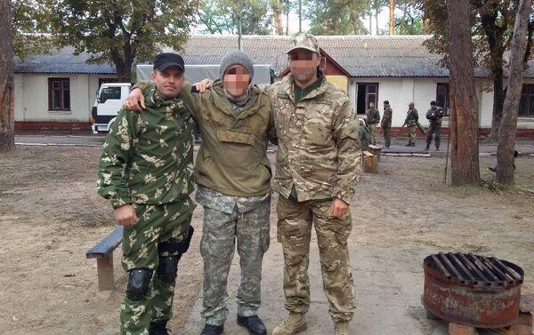Training ground of military unit 3066 'Kulchitsky's Battalion'. Sergei Sanovsky pictured left. - Sputnik International