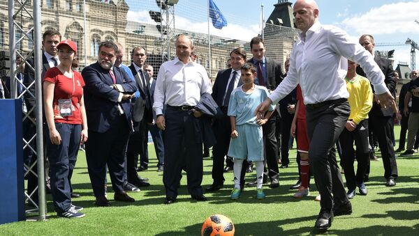 June 28, 2018. Russian President Vladimir Putin and FIFA president Gianni Infantino, right, visit the themed 2018 FIFA World Cup Football Park on Red Square - Sputnik International