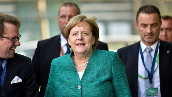 German Chancellor Angela Merkel arrives at a European People's Party (EPP) meeting ahead of a EU summit in Brussels, Belgium June 28, 2018 - Sputnik International