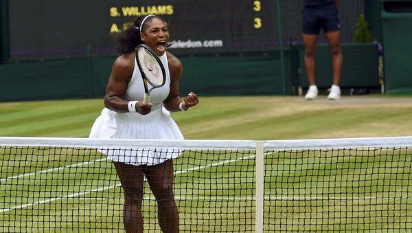 Britain Tennis - Wimbledon - All England Lawn Tennis & Croquet Club, Wimbledon, England - 9/7/16 USA's Serena Williams celebrates winning the first set in the womens singles final match against Germany's Angelique Kerber - Sputnik International