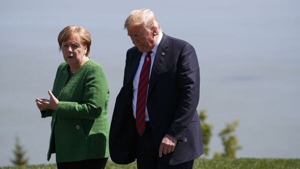 President Donald Trump, right, talks with German Chancellor Angela Merkel after the family photo during the G7 Summit, Friday, June 8, 2018, in Charlevoix, Canada - Sputnik International
