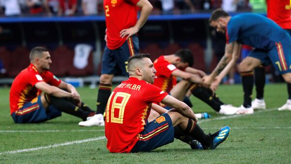 Soccer Football - World Cup - Round of 16 - Spain vs Russia - Luzhniki Stadium, Moscow, Russia - July 1, 2018 Spain's Jordi Alba and team mates look dejected after the match - Sputnik International