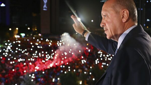 Turkey's President Recep Tayyip Erdogan, waves to supporters of his ruling Justice and Development Party (AKP) in Ankara, Turkey, early Monday, June 25, 2018. Erdogan won Turkey's landmark election Sunday, the country's electoral commission said, ushering in a new system granting the president sweeping new powers which critics say will cement what they call a one-man rule - Sputnik International