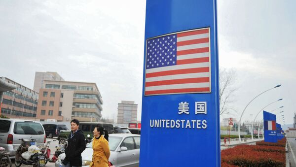 This file picture taken on April 5, 2018 shows a sign with a US flag outside a supermarket selling foreign goods in Qingdao, in China's eastern Shandong province - Sputnik International