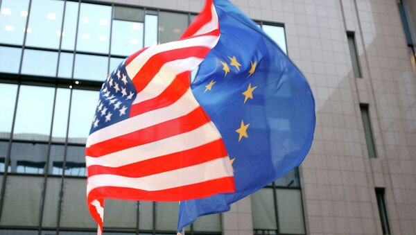 The US and EU flags, left and right, fly side by side at the European Council building in Brussels - Sputnik International
