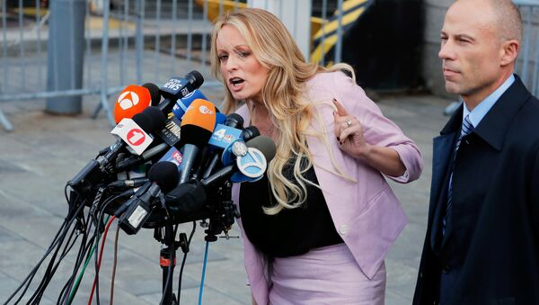 FILE PHOTO: Adult film actress Stephanie Clifford, also known as Stormy Daniels, speaks to media along with lawyer Michael Avenatti (R) outside federal court in the Manhattan borough of New York City, New York, U.S., April 16, 2018 - Sputnik International