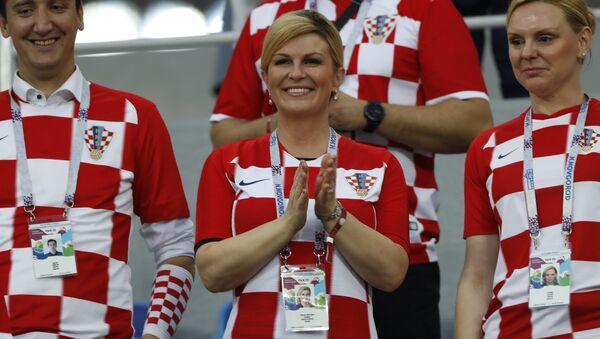 President Kolinda Grabar-Kitarovic, center, applauds prior the round of 16 match between Croatia and Denmark at the 2018 soccer World Cup in the Nizhny Novgorod Stadium, in Nizhny Novgorod , Russia, Sunday, July 1, 2018 - Sputnik International