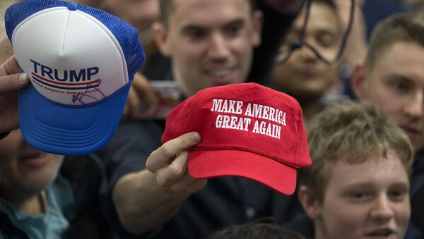 Supporters hold out their hats to get them autographed by Republican presidential candidate Donald Trump at a rally Sunday, Jan. 31, 2016, in Council Bluffs, Iowa - Sputnik International