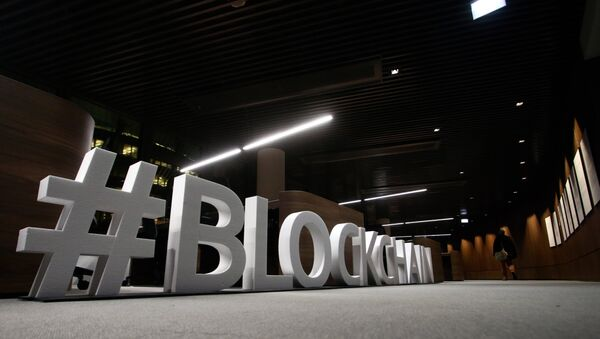Giant letters, reading the word blockchain are displayed at the blockchain centre, which aims at boosting start-ups, on February 7, 2018 in Lithuania's capital Vilnius - Sputnik International