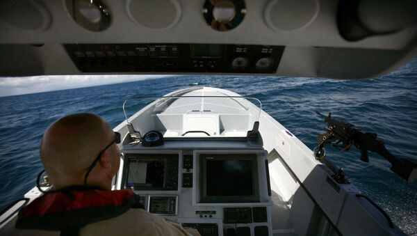 US Custom and Border Patrol Marine Interdiction Agency Supervisor Paul Pope shows the press a prototype boat during a test drive in Ceiba, Puerto Rico, Tuesday, Oct. 13, 2009.  - Sputnik International