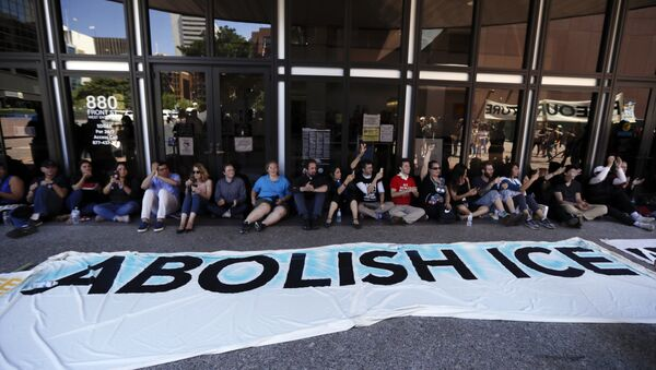 Protesters block the entrance to a downtown federal building housing Immigration and Customs Enforcement (ICE) offices Monday, July 2, 2018, in San Diego. - Sputnik International