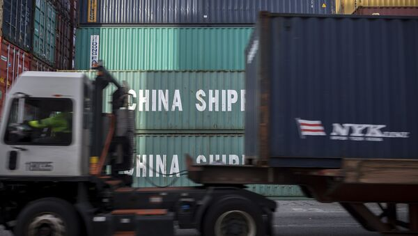 In this Thursday, July, 5, 2018 photo, a jockey truck passes a stack of 40-foot China Shipping containers at the Port of Savannah in Savannah, Ga. - Sputnik International