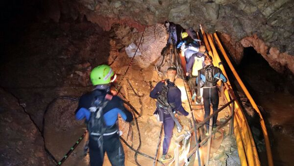 In this undated photo released by Royal Thai Navy on Saturday, July 7, 2018, Thai rescue team members walk inside a cave where 12 boys and their soccer coach have been trapped since June 23, in Mae Sai, Chiang Rai province, northern Thailand - Sputnik International