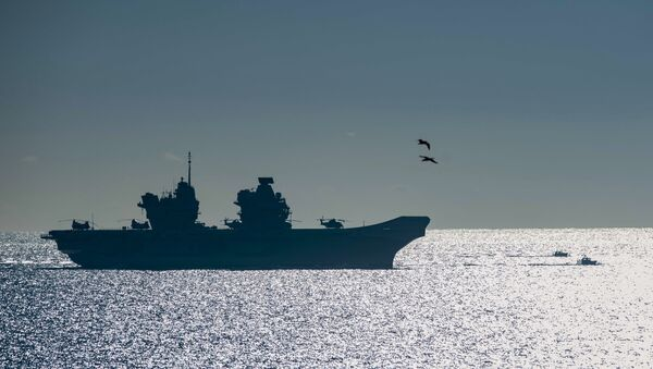 The 65,000-tonne HMS Queen Elizabeth, the largest warships ever built for the Royal Navy of the United Kingdom, arrives at the British territory of Gibraltar on Friday, Feb. 9, 2018 - Sputnik International