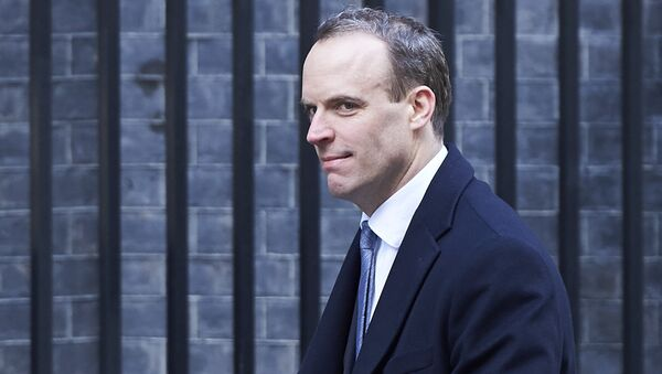 In this file photo taken on February 06, 2018 Dominic Raab, then Minister of State for Housing and Planning, leaves 10 Downing street after the weekly cabinet meeting on February 6, 2018 in London - Sputnik International
