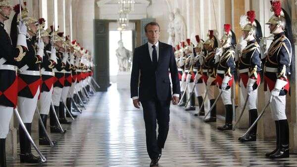 French President Emmanuel Macron walks through the Galerie des Bustes (Busts Gallery) to access Versailles' hemicycle to address both the upper and lower houses of the French parliament at a special session in Versailles, near Paris, 9 July 2018. - Sputnik International