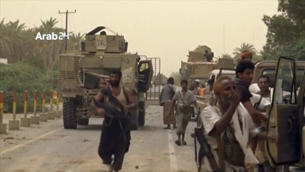 This Saturday, June 16, 2018 file still image taken from video provided by Arab 24 shows Saudi-led forces gathering to retake the international airport of Yemen's rebel-held port city of Hodeida from the Shiite Houthi rebels. - Sputnik International