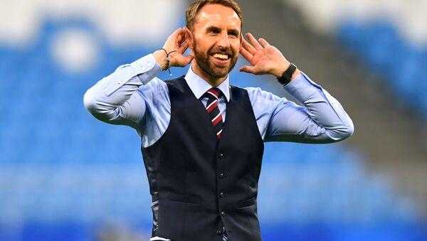 England manager Gareth Southgate salutes their fans after the match. - Sputnik International