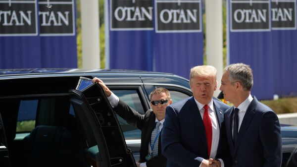 US President Donald Trump (L) and NATO Secretary General Jens Stoltenberg (R) are shaking hands at the meeting of NATO Heads of State and Government in Brussels, Belgium on 11 July 2018 - Sputnik International