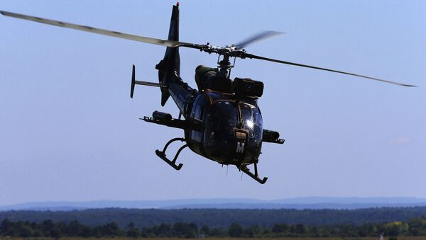 A French army Gazelle helicopter participates on June 26, 2018, during military manoeuvres at the Combined Armed Forces Shooting Training Center (CETIA-S) in Suippes, eastern France. - Sputnik International